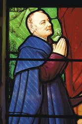 Détail du vitrail XIXe siècle de la chapelle : portrait d'André Leroy en donateur © Copyright Marc Chevalier